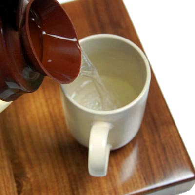 Fresh Brewed Hot Water Poured in Cup